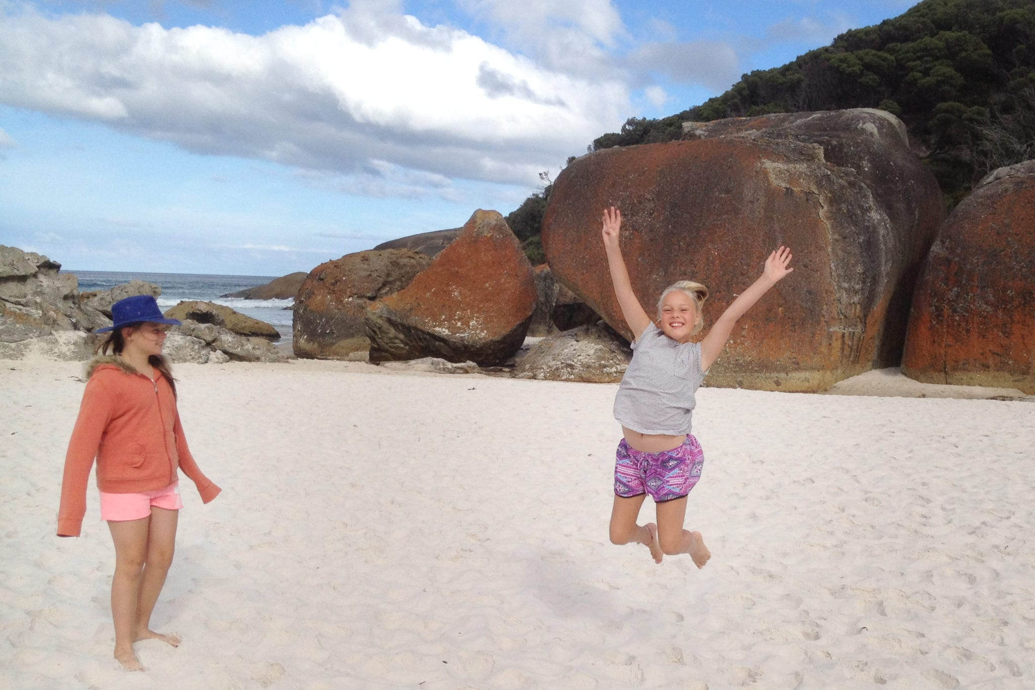 Wonthaggi-North-Primary-two-girls-at-beach-fieldtrip-one-jumping-for-joy